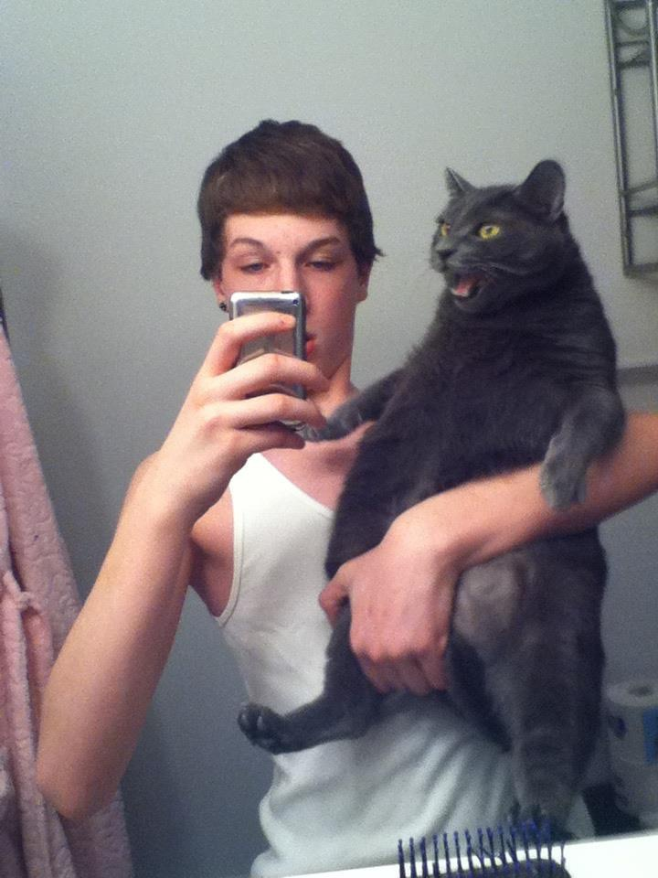 I think this is not how you hold a cat...