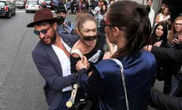 Gigi Hadid manhandled by random guy after a show for Milan Fashion Week