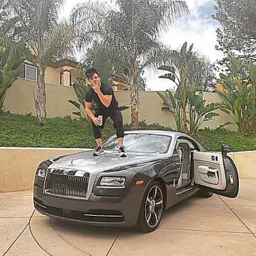 #RichKidsOfInstagram: Danny Agha Standing on His Rolls Royce Wraith Hood