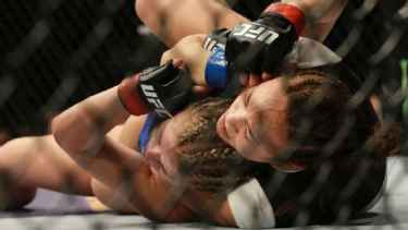 #UFC Fight Night: Michelle Waterson submits Paige VanZant in first round choke hold