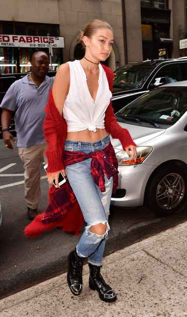 Gigi Hadid red cardigan, distressed denim, and boots fall style