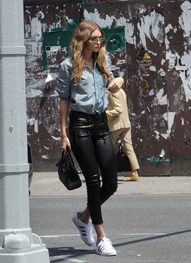 Gigi Hadid in leather pants and denim shirt #StreetStyle