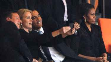 President Barrack Obama selfie with British and Danish Prime Ministers during Nelson Mandela funeral