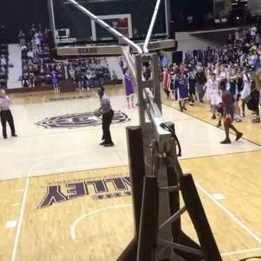 Referee Stuns Players by Throwing a Windmill Dunk