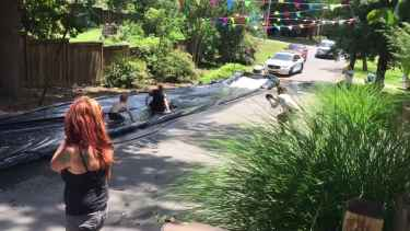 Cops Were Called over Slip N' Slide but Instead Joined the Fun