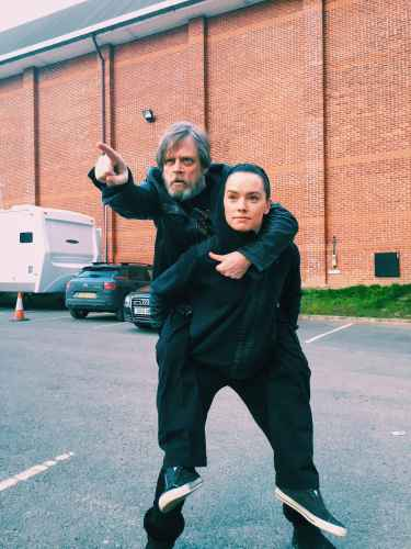 Daisy Ridley carries Mark Hamill at her back
