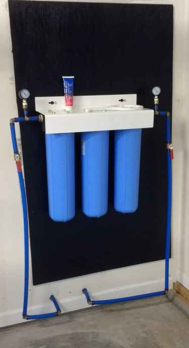 Three stage whole house water filtration system installation