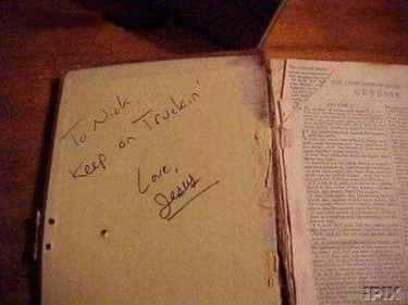 This must be fake Jesus signature, the book doesn't look that old...