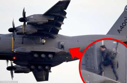 Mission: Impossible's Tom Cruise hangs horizontal outside moving plane