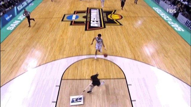 This girl mopping the basketball court floor almost got dunked on #LOL